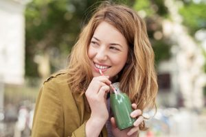girl drinking green juice